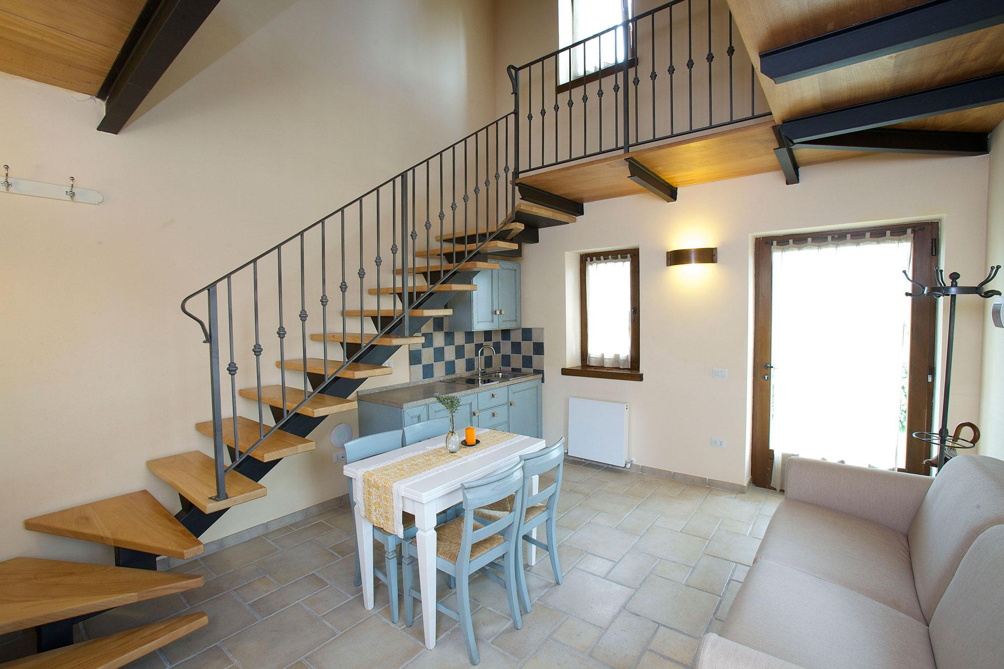 Soggiorno e angolo cottura appartamento Lavanda - Paradiso44